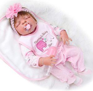 Bébé reborn fille avec bandeau dans les cheveux