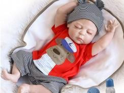 Bébé reborn garçon endormi